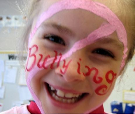 girl with bullying sign on face